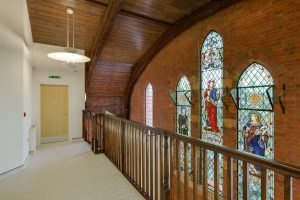 image-top-floor-landing-panacea-medical-center-featuring-stained-glass-mural