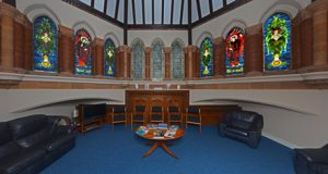 wating-room-panacea-with-feature-stained-glass-wood-carving-mosaics
